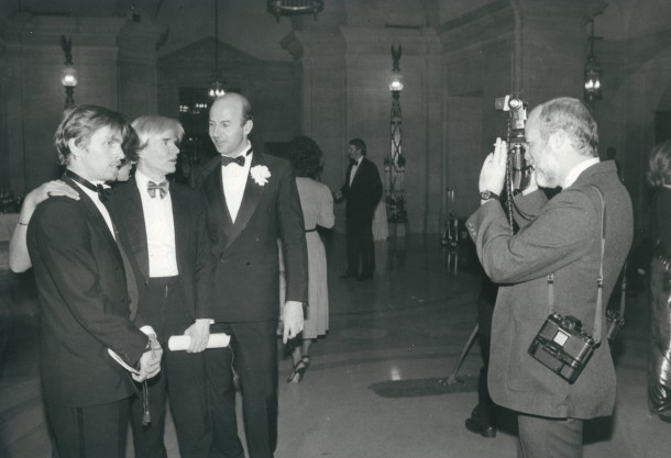 Pop Art artist Andy Warhol, in 1984, poses for photos with guests at The White House